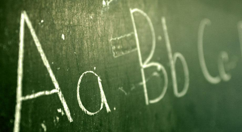 Green chalkboard with the letters A, B and C on it in upper and lower case.
