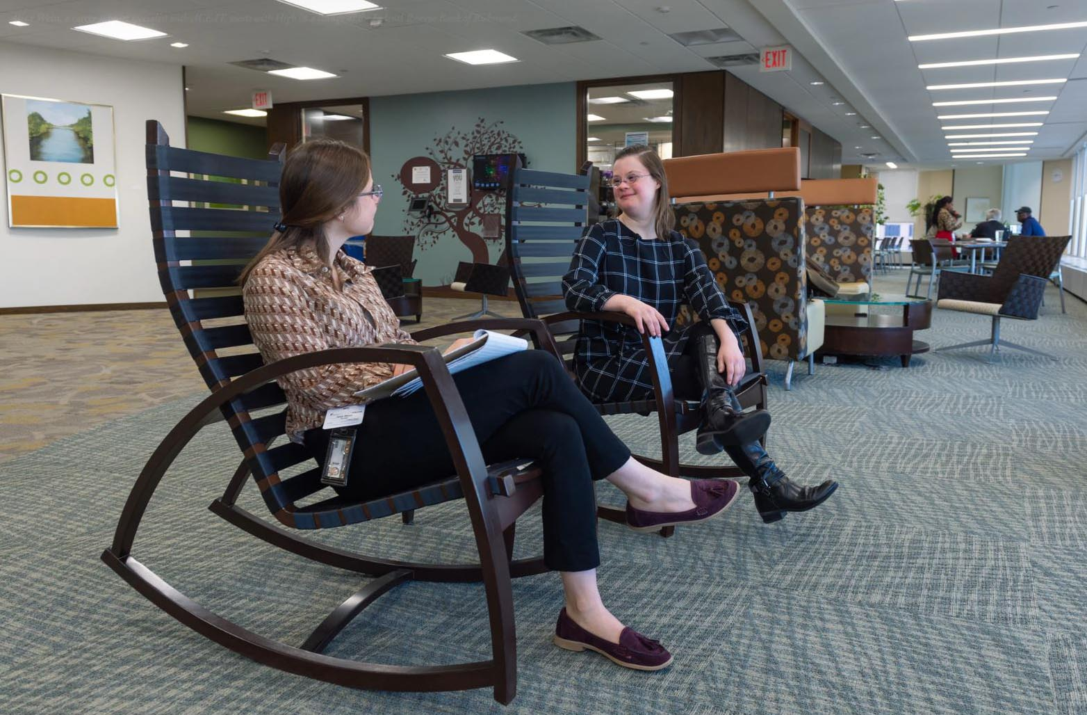 Aliza Weiss, a career support specialist with ACE-IT, meets with High in a lounge at the Federal Reserve Bank of Richmond.