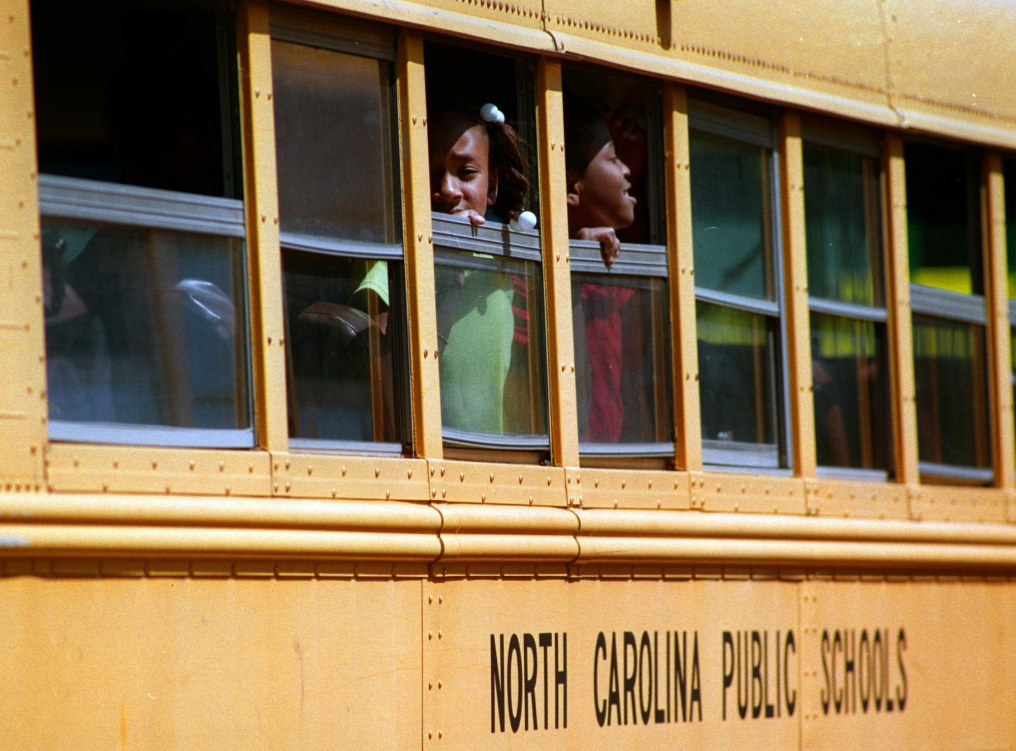 Schoolchildren in Huntersville, N.C., a suburb of Charlotte, in 1999. Two years later, a court order ended a comprehensive desegregration plan in the Charlotte school district that included busing. (Todd Sumlin/The Charlotte Observer)